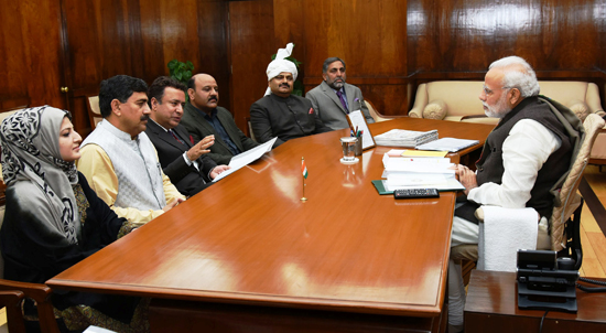 Prime Minister Narendra Modi in a meeting with delegation in Parliament Hall, New Delhi on Friday.