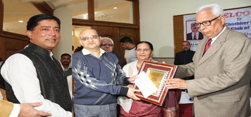 Governor N N Vohra presenting 'Journalist of the Year' award to Sanjeev Pargal and Vivek Singh at Press Club Jammu on Tuesday. -Excelsior/Rakesh