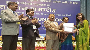 Union Minister Dr Jitendra Singh presenting completion certificates of Foundation training course organized by Institute of Secretariat Training and Management (ISTM),affiliated to Department of Personnel & Training (DoPT), at DRDO Bhawan, New Delhi on Friday.