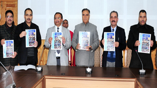 Judges of the High Court and others releasing newsletter of J&K State Judicial Academy at Jammu on Tuesday.