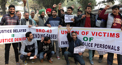 Wards of deceased police personnel during a protest near Press Club, Jammu. —Excelsior/Rakesh