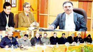J&K Bank Chairman Parvez Ahmed and members of FCIK during meeting at Srinagar.