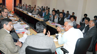 PHE Minister Sham Choudhary chairing a meeting on Friday.