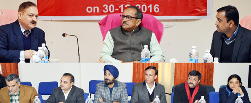 Deputy Chief Minister Dr Nirmal Singh chairing a meeting at Billawar on Friday.