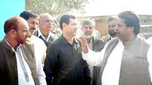 Senior Cong leader Raman Bhalla talking to people from Bathindi and Rajeev Nagar in Jammu on Sunday.