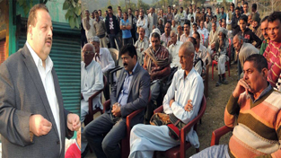 MLA Devender Singh Rana addressing a public meeting on Friday.