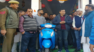 Former Minister, Sham Lal Sharma interacting with people after inaugurating Regency Honda's showroom at Akhnoor.