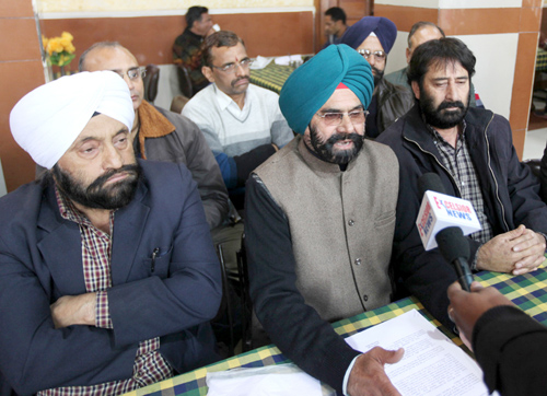 Employees leaders Kulwant Singh and others addressing joint press conference in Jammu on Friday. -Excelsior/Rakesh