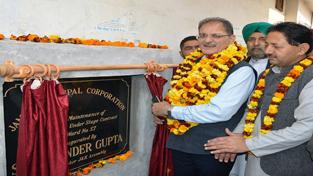 Speaker Legislative Assembly Kavinder Gupta laying foundation stone of development work.