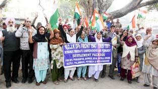 Displaced persons from PoJK staging protest near Press Club in Jammu  on Monday.     -Excelsior/ Rakesh