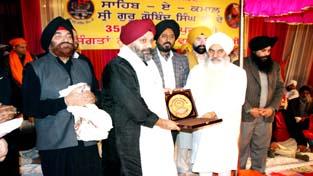 Mahant Manjit Singh felicitating dignitaries during religious function in Jammu.