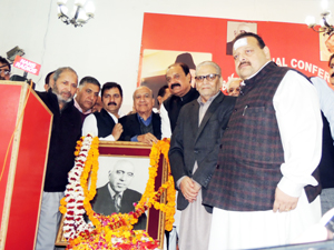 National Conference Provincial President Devender Singh Rana & others paying floral tributes to Sheikh Mohammed Abdullah at Jammu on Monday.
