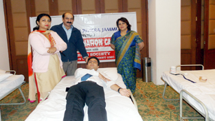 An employee donating blood during a camp by Hotel Fortune Inn Riviera on Monday.