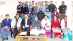 Red Cross officials and other guests posing with trainees at Kachi Chawni, Jammu.