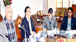 Minister for Public Works Abdul Rehman Veeri chairing a meeting at Srinagar on Tuesday.
