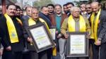Speaker Kavinder Gupta and recipients of 'Lifetime Humanitarian Awards posing for group photograph.