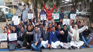 NPP activists and contractual lecturers staging protest dharna near Press Club in Jammu on Sunday.