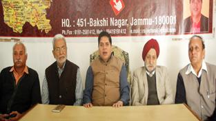 SOS International chairman Rajiv Chuni addressing press conference in Jammu. — Excelsior/Rakesh