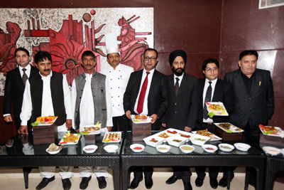 General Manager, Hotel K C Residency, Rahul Jandial, along with other officials and chefs showcasing Kashmiri cuisine at 'The Terrace Skylounge'.
