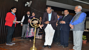 Guest lighting ceremonial lamp during inaugural of ITS conference at JU on Friday.