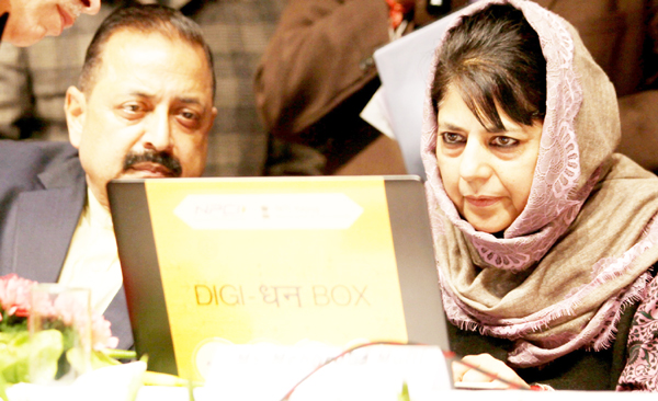 Chief Minister, Mehbooba Mufti and Dr Jitendra Singh during the Digi Dhan Mela at Jammu on Tuesday. -Excelsior/Rakesh