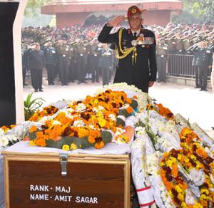 Chief of Army Staff, General Bipin Rawat paying homage at the mortal remains of Major Amit Sagar, in New Delhi on Sunday.