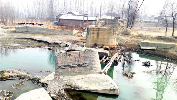 A view of a broken bridge that was damaged due to 2014 floods at Gadoora in Pulwama. -Excelsior/Younis Khaliq