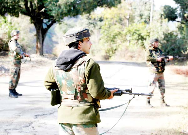Troops during searches in Jogma area of Akhnoor sector on Monday. -Excelsior/Rakesh