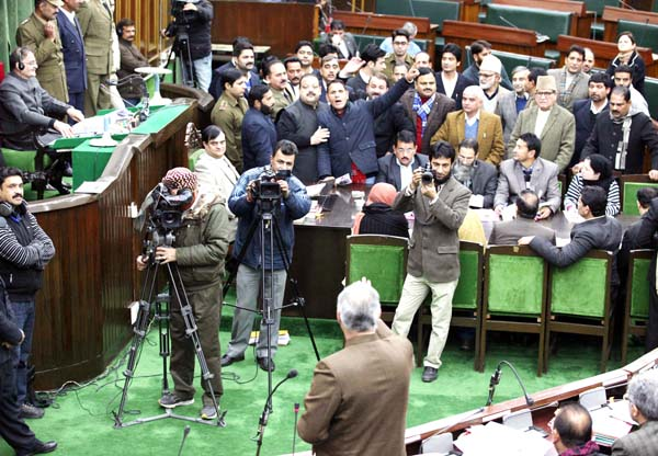 Opposition MLAs protesting in Well of the Assembly on Monday. -Excelsior/Rakesh