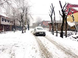 A view of snowfall in Baramulla on Thursday.