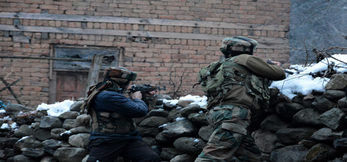 Security forces in action during encounter at Awoora in Anantnag on Sunday. — Excelsior/Younis Khaliq