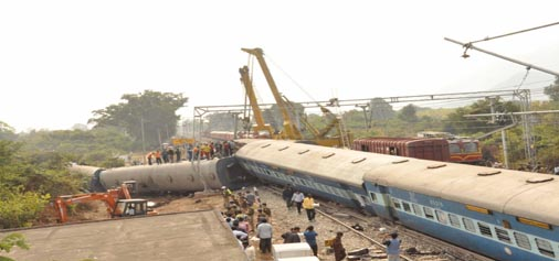 Mangled remains of coaches of the ill-fated Jagadalpur-Bhubaneswar Express train which derailed at Kuneru Railway Station in Kumarada Mandal in Vizianagaram district of Andhra Pradesh on Saturday night.(UNI)