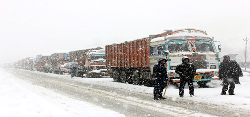 Trucks stranded at Qazigund after National Highway was closed for vehicular traffic due to snowfall. -Excelsior/Younis Khaliq