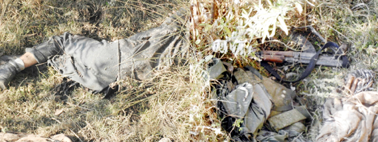 Body of a militant killed in a encounter and arms recovered in Poonch on Wednesday.