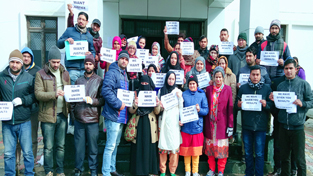 NHM employees staging protest in front of District Hospital, Doda on Wednesday.