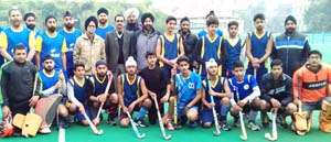 Players posing alongwith the officials and organizers during a match of Baba Fateh Singh Memorial Hockey Tournament in Jammu.