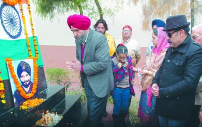 Floral tributes being paid to martyr S Saroop Singh at Dorga Shaurya Sthal on Saturday.
