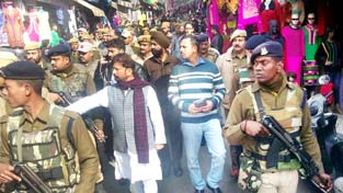 Minister for Forest Choudhary Lal Singh and team from State Pollution Control Board during surprise checks in Jammu city markets on Friday.