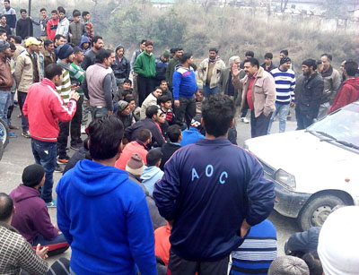 Villagers protest for probe into mass failure of students.