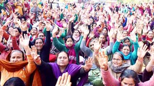Anganwadi workers raising slogans during a protest demonstration at Jammu on Thursday.