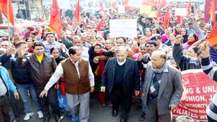 ASHA, Anganwari and Mid-Day Meal workers led by M Y Tarigami taking out rally in Jammu on Friday. -Excelsior/Rakesh