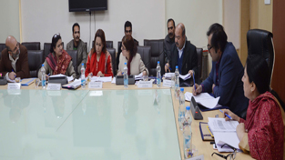 Minister for Social Welfare Sajad Gani Lone chairing a meeting at Jammu on Monday.