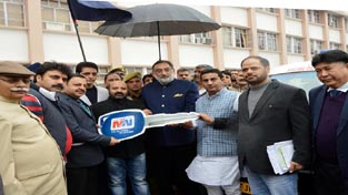 Minister for Finance Dr Haseeb Drabu giving keys of ambulances to Minister for Health & Medical Education at Jammu on Tuesday.