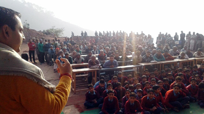 MLA R S Pathania addressing public meeting in remote area of Ramnagar.