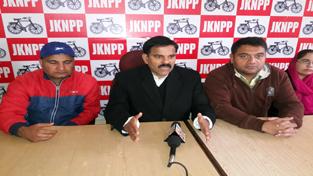 NPP leader Harshdev Singh addressing press conference in Jammu on Sunday.