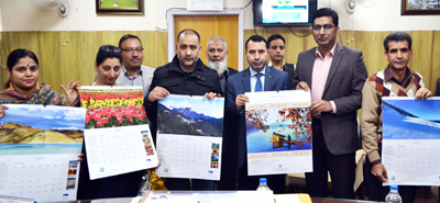 Tourism Secretary Farooq Shah, Managing Director JKTDC, Dr Shahid Iqbal Choudhary & others launching calendar of JKTDC on Saturday.