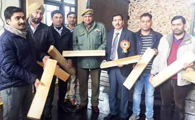 Team of Excise Deptt. with seized willow cleft at Lakhanpur on Friday. —Excelsior/Pardeep