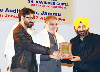Legislative Assembly Speaker Kavinder Gupta honouring Times Now Bureau Chief Pradeep Dutta for his bold reporting in Jammu on Saturday.