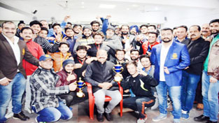State BJP Vice President Yudhvir Sethi posing alongwith Power Lifters in Jammu on Sunday.