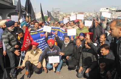 J&K SRTC workers staging protest in Jammu on Monday. —Excelsior/ Rakesh